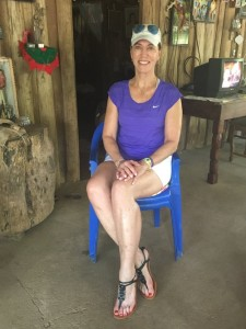The author sits in Panchita's favorite plastic blue chair on the insistence of Panchita's granddaughter, Magdalena, that it might provide good luck with the author's own longevity.
